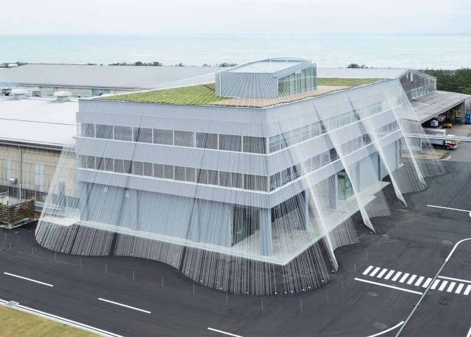 This  office building was renovated in rigid-frame RC structure to strengthen its earthquake resistance by using carbon fiber, and transform the interior into a museum called Fab Labo, a space to display the technology of Komatsu Seiren, the client company. Drawing inspiration from a technique of braiding ropes indigenous to this part of Japan, the fiber rod is said to be ten times stronger than iron, and is the very first time that this material was used as a means of reinforcement against earthquakes. The potential of this light and soft fiber is explored inside the building as well. There is a lighting duct in fiber and on the rooftop, an experimental greening is being conducted using porous ceramic panels (called Greenbiz), which was generated from the process of producing fiber.  Photo 4 of 13 in Architect Spotlight: 12 Works by Japanese Architect Kengo Kuma