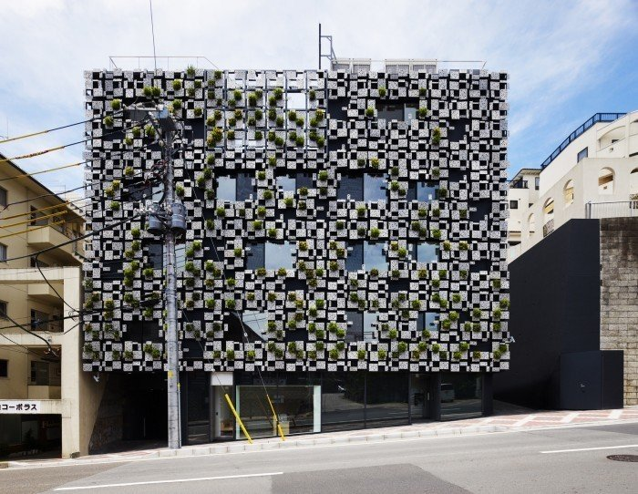 The façade of the Green Cast building is covered with planters made of aluminum die-cast panels. The 3 (up to 6) aluminum panels, which also form planters, are made in monoblock casting. Each panel is slanted, and its surface appears to be organic, of which cast comes from decayed styrene foam. Equipment such as watering hose, air reservoir for ventilation and downpipes are installed behind the panels so that the façade can accommodate a comprehensive system for the building.  Photo 8 of 13 in Architect Spotlight: 12 Works by Japanese Architect Kengo Kuma