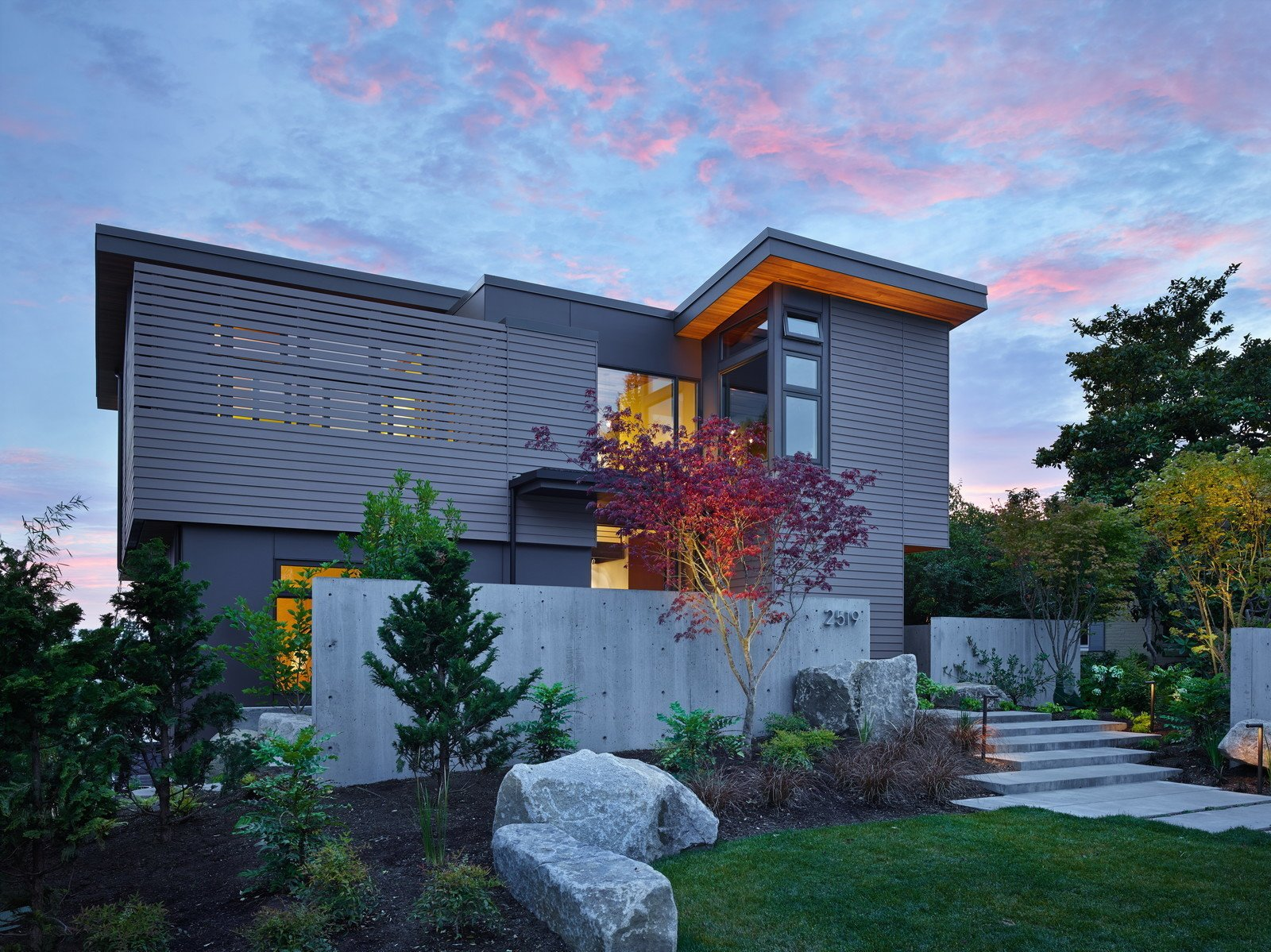 """This cozy urban retreat was designed to take advantage of Sound and Olympic Mountain views and highlight the owners' collection of NW art. A central steel + glass stair creates a """"vertical gallery"""" filled with art and awash with natural light. On the top floor, living, dining and cooking spaces share two decks. One is secluded and captures morning light. The other opens up to sunsets and sweeping views.  Photo 6 of 12 in 11 of Our Favorite Pacific Northwest Homes From the Community"""