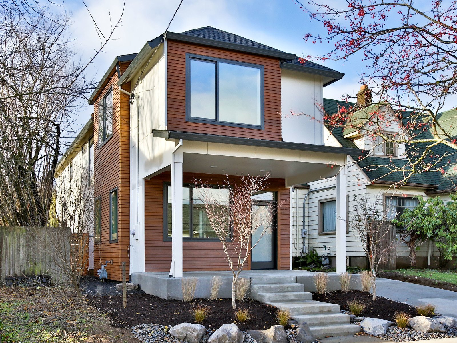 Clean modern lines and finishes are the foundation of this brand new home in Portland. Abundant windows bring natural light and a modern kitchen + dining area open on the back yard.  Photo 12 of 12 in 11 of Our Favorite Pacific Northwest Homes From the Community