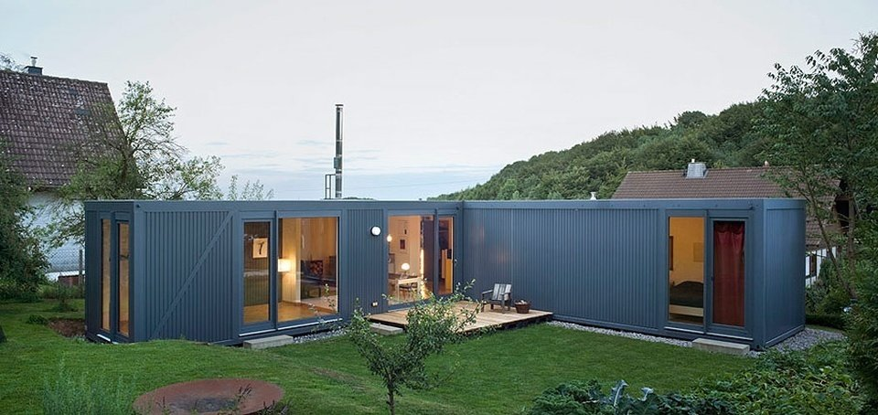 Exterior, Shipping Container Building Type, Prefab Building Type, Glass Siding Material, Metal Siding Material, and Flat RoofLine This modern prefab shipping container home in  Germany was designed by Cologne-based studio LHVH Architekten.  Photo 8 of 10 in 10 Steel Prefabs That Are Both Modern and Practical