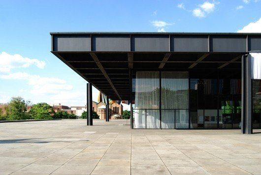 The Neue National Galerie (New National Gallery) by Ludwig Mies van der Rohe midcentury style building with glass and steel exteriors and steel roof with flat roofline