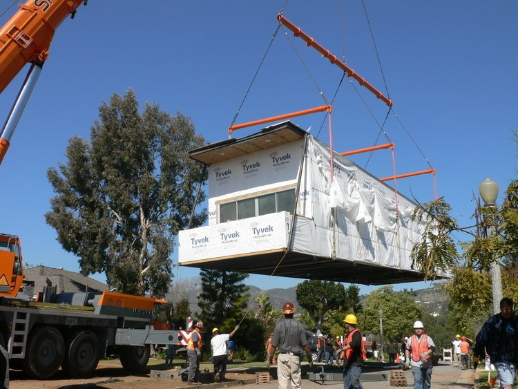 The Palisades Prefab being lowered into place.  Photo 9 of 15 in Eco-Friendly Prefabs and the Modern Mobile Home: Spotlight on Jennifer Siegal
