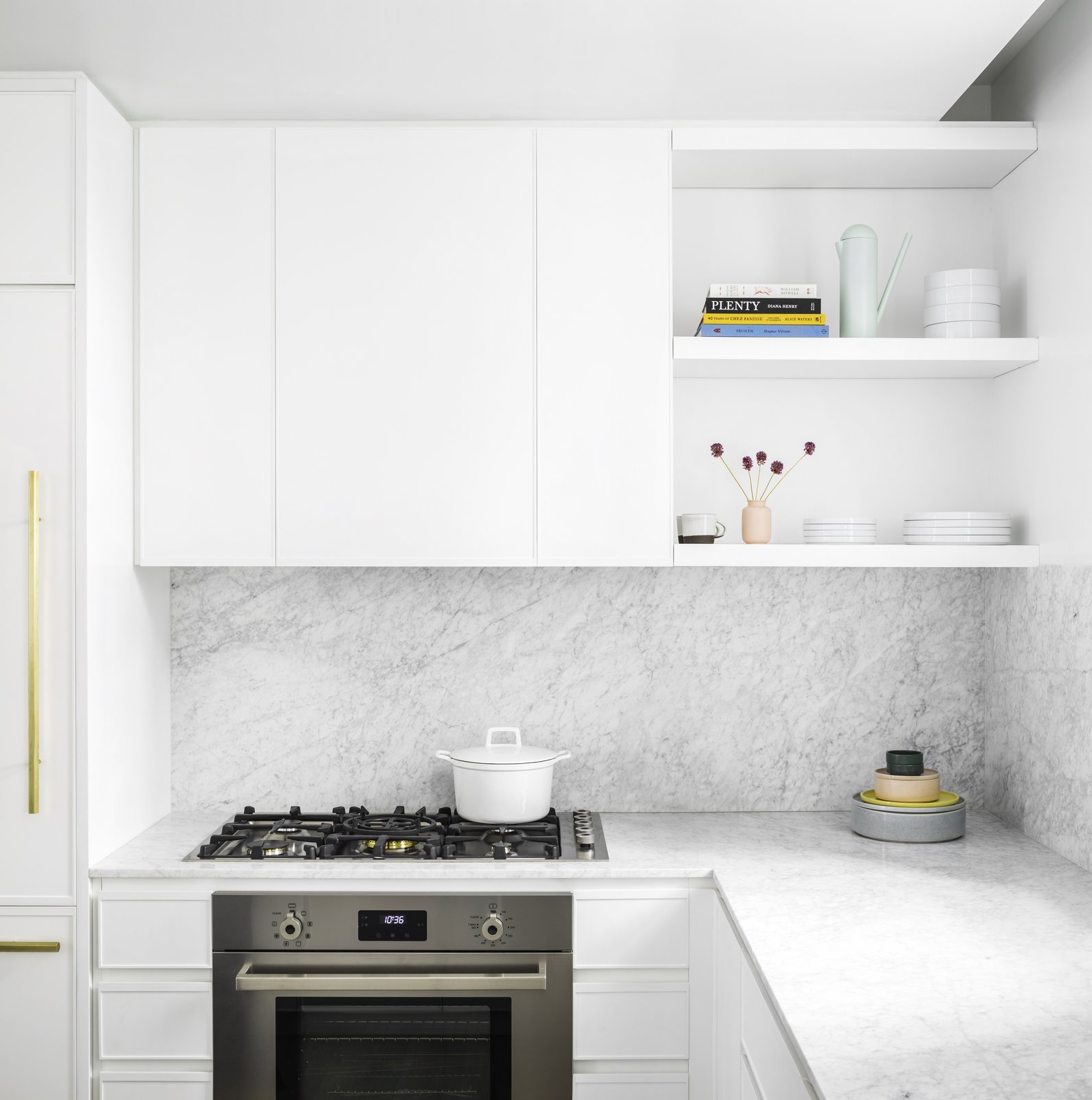 Kitchens	are	fully	outfitted	with	Bertazzoni-Italia	and	Bosch	appliances	and	Italian	Carrara	marble	slab	countertops.  Photo 5 of 9 in Formerly Home to Superman, The Standish Offers Modernized Beaux-Arts Condos From $1.3 Million
