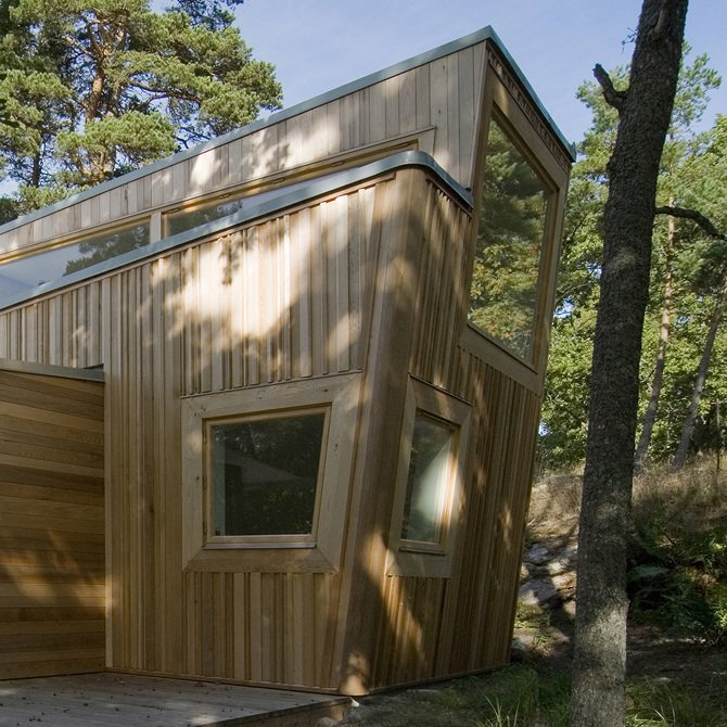 Exterior, Cabin Building Type, and Wood Siding Material Built entirely of wood, this cabin in the forest of Ingarö was constructed in close collaboration with local builders and local woodworking companies and was inspired by its sylvan setting.  Photo 8 of 10 in A Look at 10 Minimalist Scandinavian Cabins
