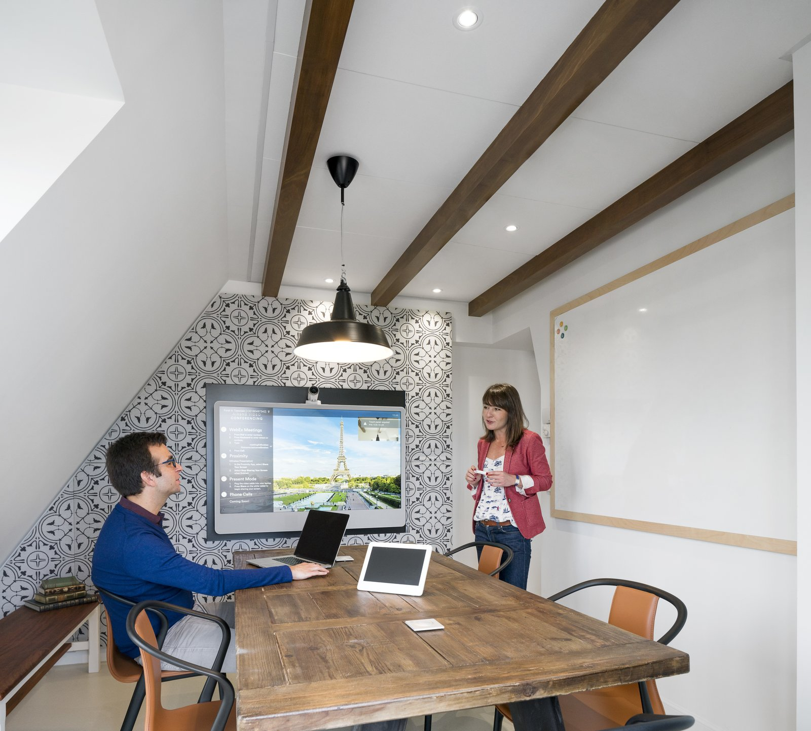 With a traditional mansard roof, a variety of levels and atypical corners, the office resembles a quaint attic loft synonymous with Parisian city architecture.  Photo 5 of 14 in Take a Peek Inside Airbnb's New Loft-Inspired Office Space in Paris