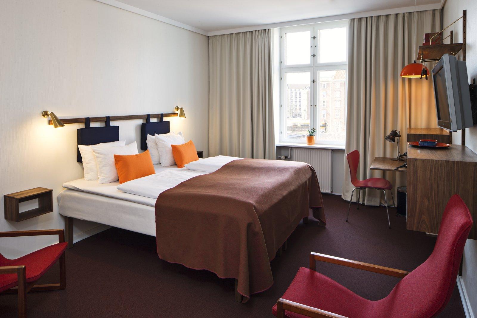 Bedroom, Bed, Chair, Wall Lighting, Pendant Lighting, and Carpet Floor Standard Double Room  Photos from Get Your Fix of Midcentury Scandinavian Design at This Copenhagen Hotel