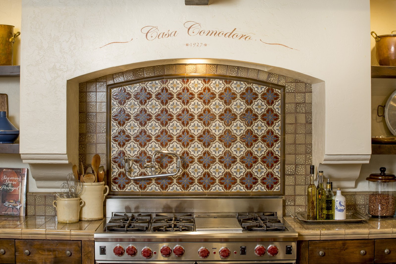 Hand-painted tiles make for a charming backsplash. The kitchen was designed in collaboration with Fleetwood Joiner and & Associates to closely match the style of the home.  Photo 4 of 9 in Just Listed at $4M, This Spanish Colonial Revival in Southern California Promises Resort-Like Living