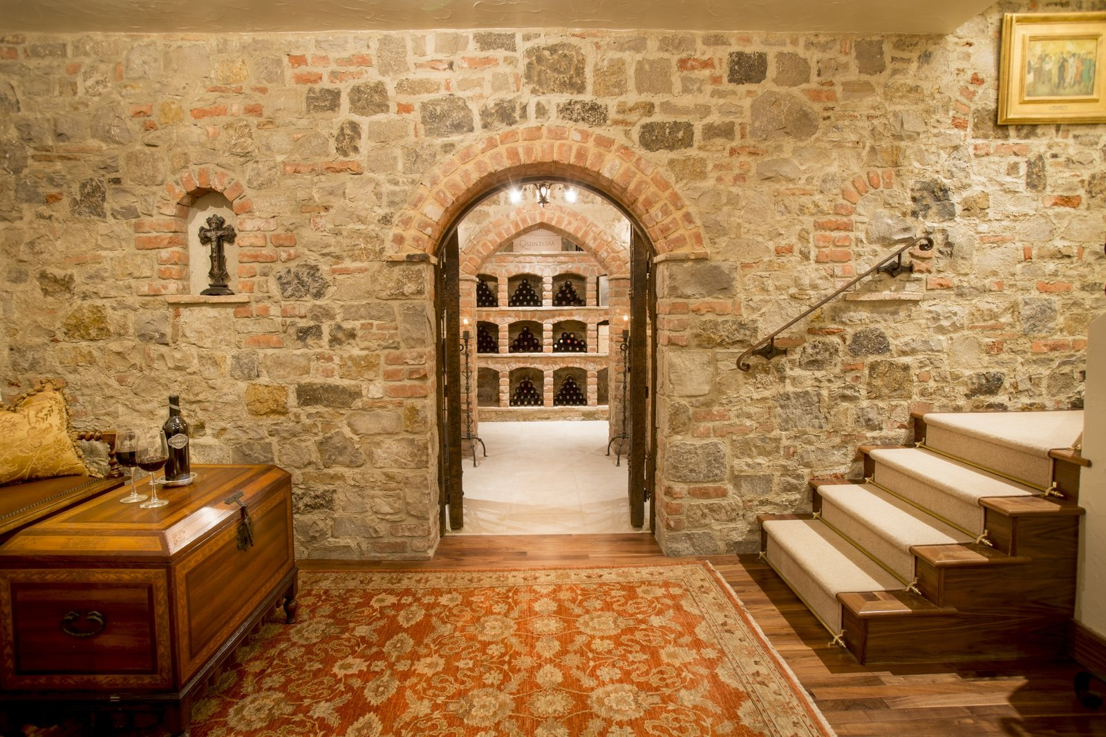 The wine cellar was formerly a speakeasy. Crafted from imported Italian brick, it has a360-bottle capacity and features a completely dedicated thermostat and humidifier with a hand-forged, 1000-pound custom door.  Photo 9 of 9 in Just Listed at $4M, This Spanish Colonial Revival in Southern California Promises Resort-Like Living