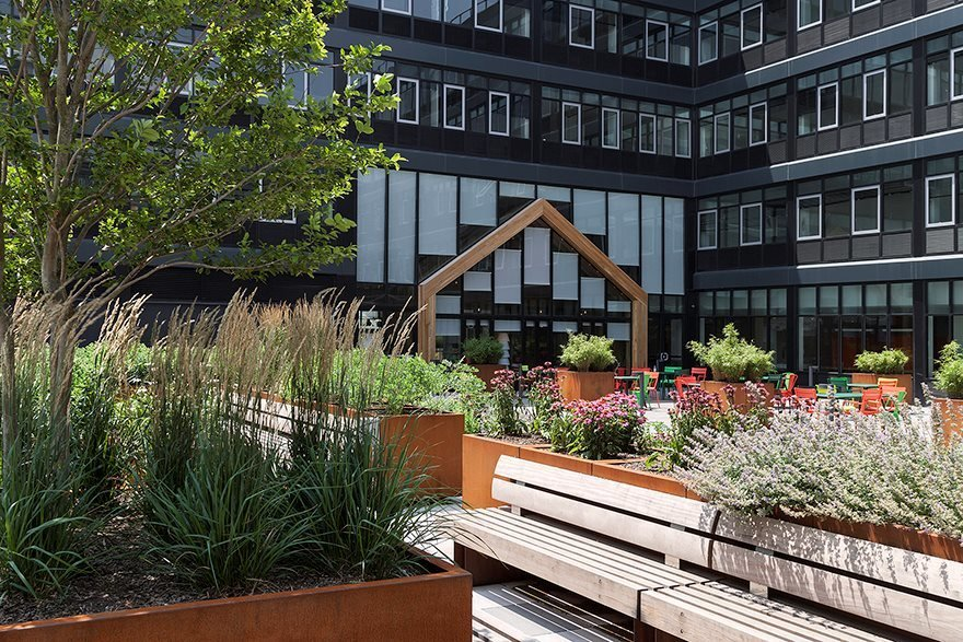 With over 50 varieties of produce the plot also includes a greenhouse and picnic tables for shared dining.  Photo 6 of 8 in 3 New York City Residential Projects That Feature DIY Urban Gardens