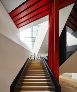 The engineering and construction challenge is made visible to the public by steel columns and a beam that's painted in vivid international orange. It literally holds the weight of history and the Museum's priceless collections above.