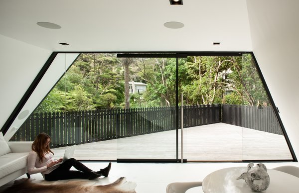 Inside, the complex interplay of angles creates an energised feeling of space that belies the modest floorplan. This is enhanced by the full-height glazing on the north face, which draws in the deck and the wetland bush beyond.
