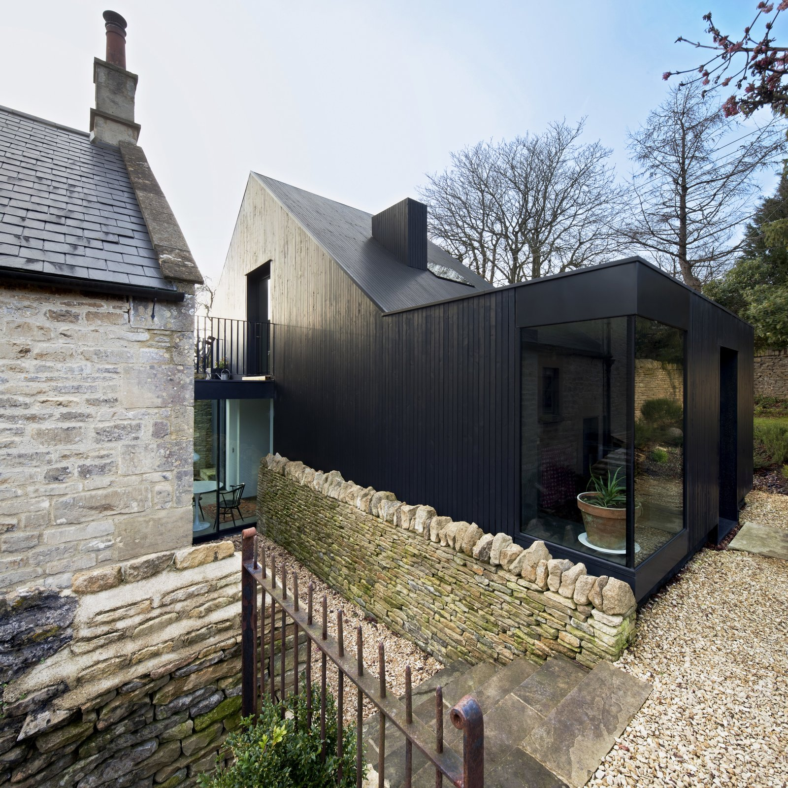 To complement this renovation for a Bath stone and slate Baptist church from 1867 in Wiltshire, UK,   Jonathan Tuckey Design used blackened timber  as a direct reference to the tin tabernacle churches, which are a vernacular type of the rural West Country part of England to the southwest of London.  color