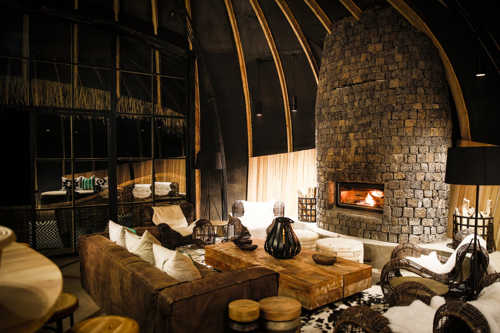 This volcanic mountainous terrain also resonates in the volcanic stone that is used in Bisate's fireplaces and its surrounds, while natural 'flamed' granite is used for many surfaces.  Photo 9 of 11 in Take an Eco-Escape to a Spherical Forest Villa in an Eroded Volcanic Cone in Rwanda