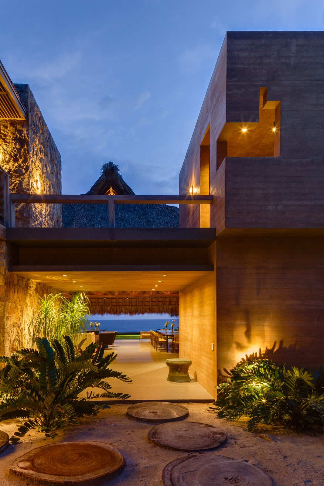 Outdoor, Landscape Lighting, Walkways, Shrubs, and Side Yard The home features a stunning view of a private beach.  Photo 3 of 14 in This Expansive Beachside Home on Mexico's Pacific Coast Puts a Modern Spin on Tradition