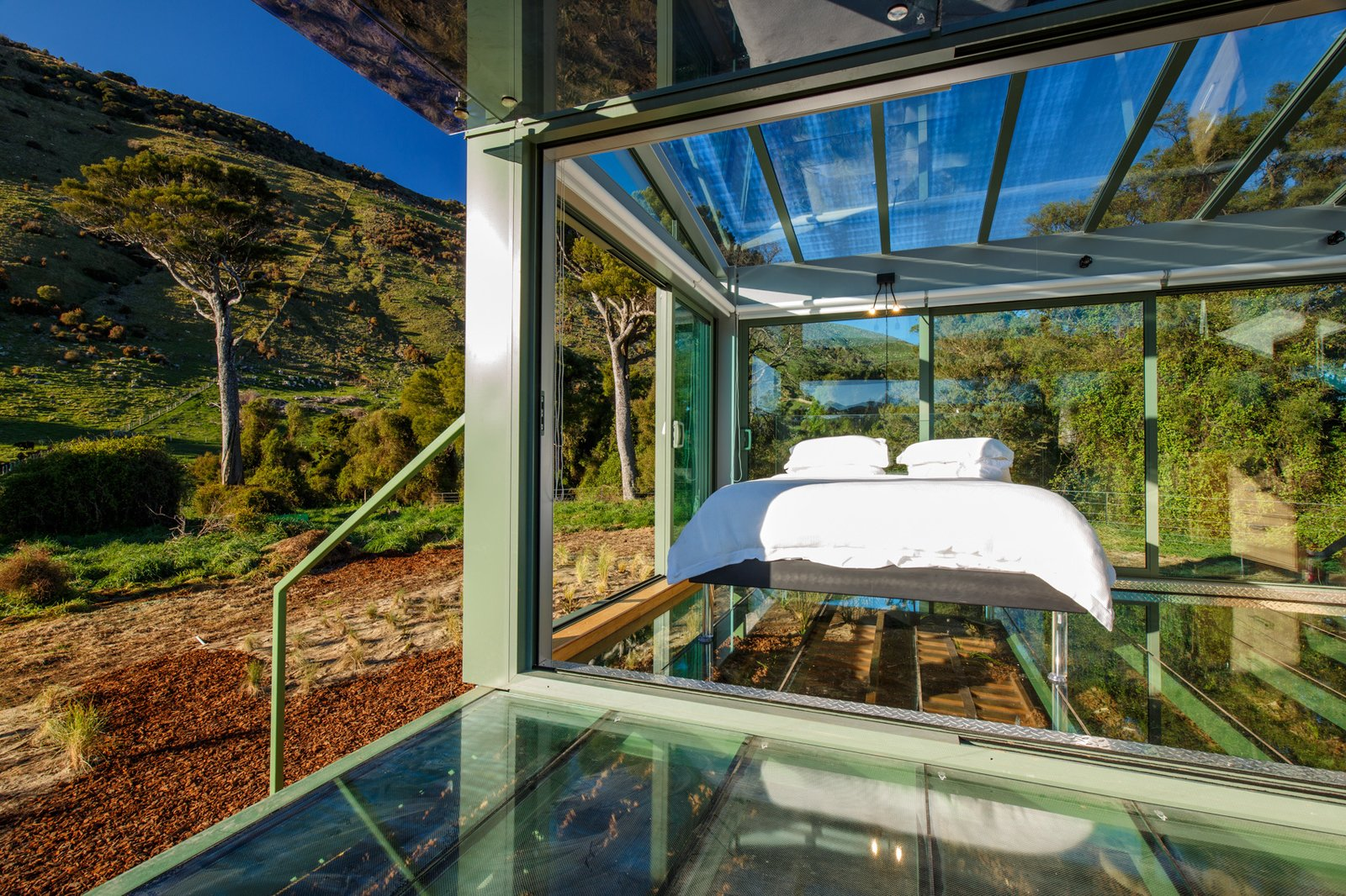 The interiors of the PurePod are completely surrounded by glass.  Photo 7 of 17 in 8 Unique Vacation Rentals Around the World
