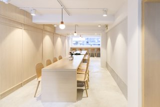 The second floor features two communal tables that can be pushed together to form one long table for special events.