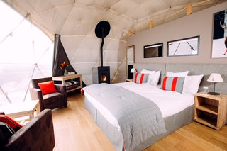 The interior decor is inspired by a modern glamping lifestyle.