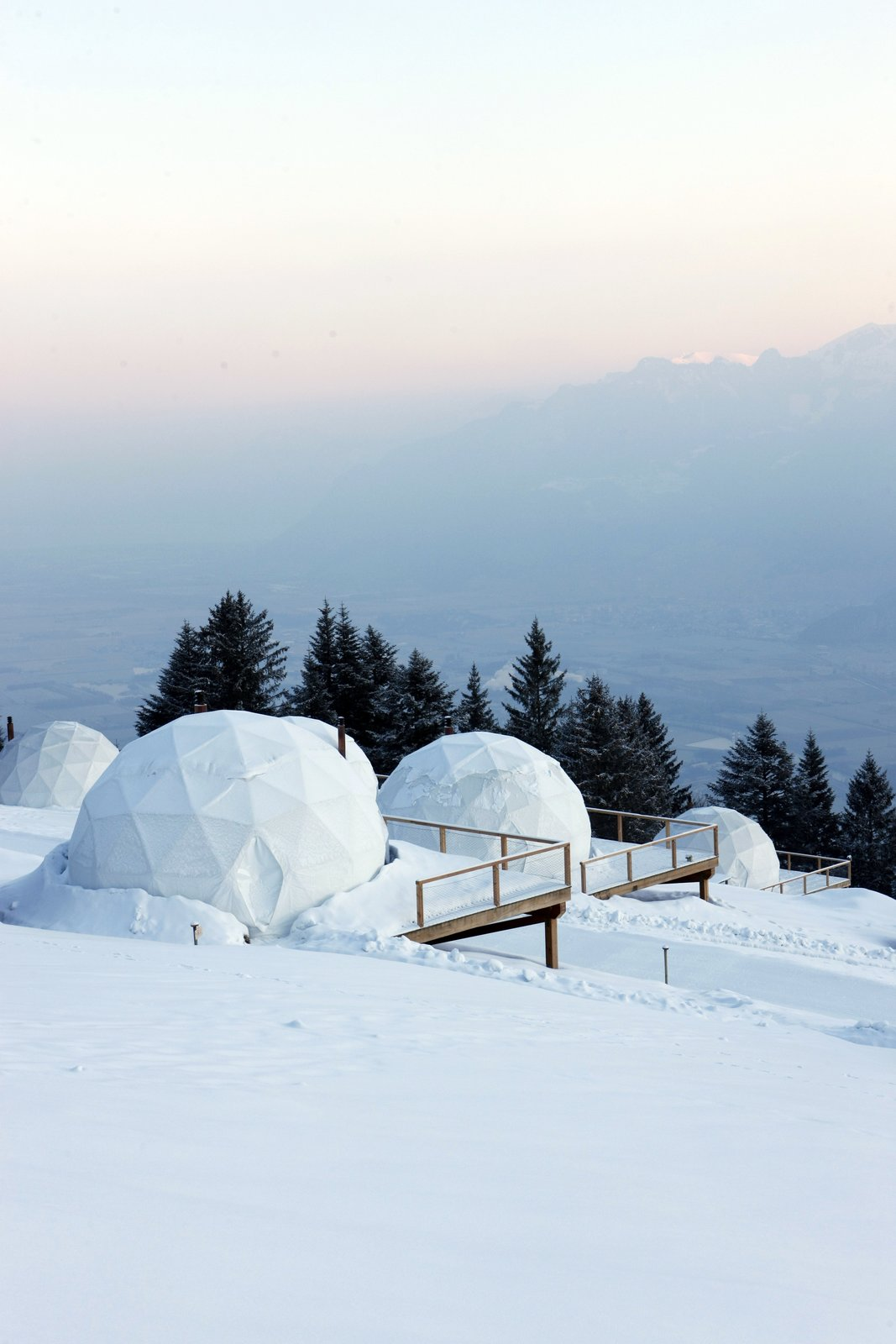 Exterior, Dome, Prefab, Cabin, Glass, and Tent The geodesic domes look like igloos in the snowy Alpine landscape.  Best Exterior Prefab Glass Dome Photos from Go Eco-Friendly Glamping in These Geodesic Domes in the Swiss Alps