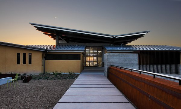 Law Estates Wines spans 55 acres with full panoramic views of the Paso Robles countryside. The building reflects that of their varietals—showcasing natural characteristics in minimalist style. The design is a direct response to the natural materials of the site, its hillside topography, and climatic influences of the sun and wind.
