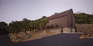 Eschewing the typical white barn vernacular commonly found throughout Napa Valley, Fernandez turned to the rustic architectural traditions of western mining communities for inspiration.