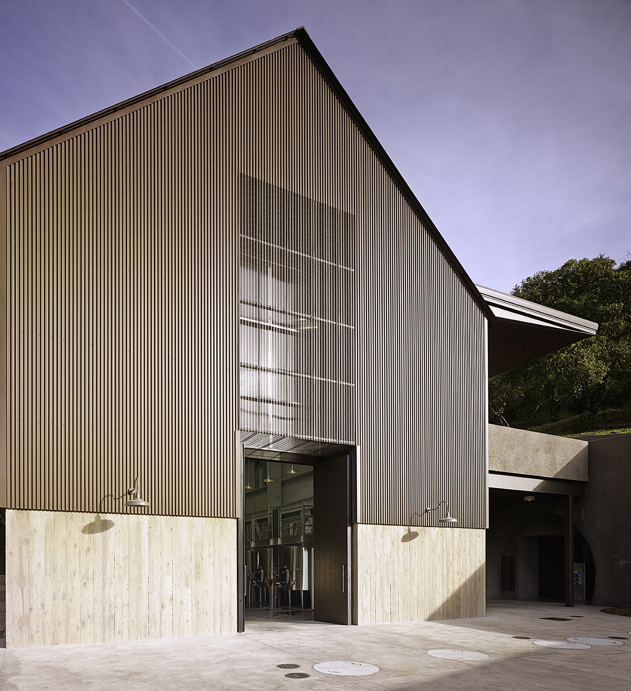 Exterior, Metal, Metal, and Barn Steep roofs and tall internal spaces provide barnlike simplicity and facilitate an efficient multilevel design.  Best Exterior Metal Barn Photos from 6 Modern Wineries on the West Coast With Beautiful Architecture