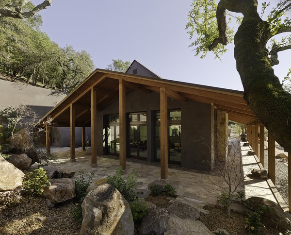 A wrap-around porch shelters visitors from the hot summer sun and protects from the winter rains that are characteristic of Napa Valley.