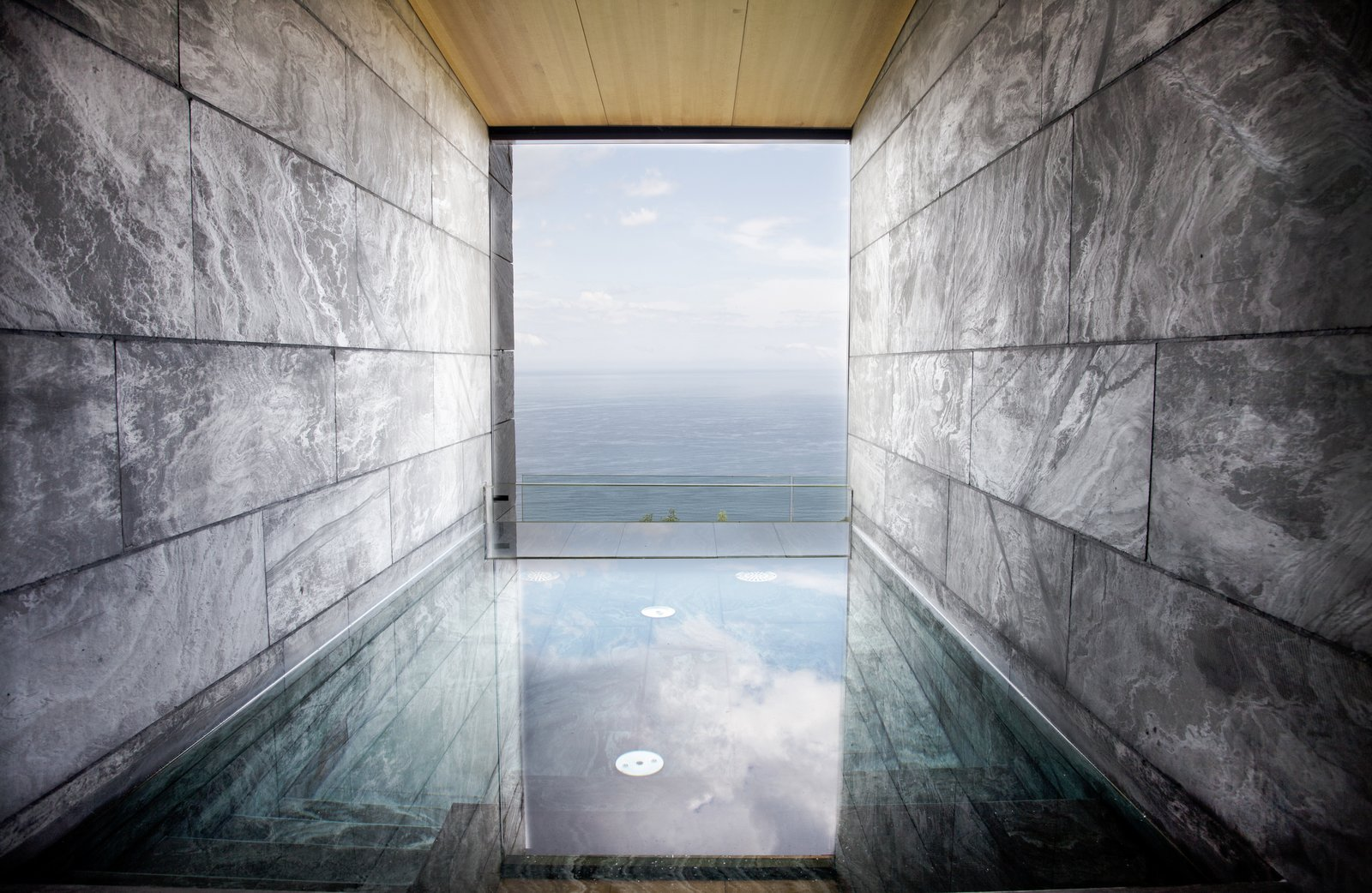 Bath Room and Soaking Tub The wellness area is divided into two areas: a wet zone with a stone swimming pool, sauna, and a Turkish bath; and a separate zone for spa treatments.  Photo 11 of 40 in 40 Modern Bathtubs That Soak In the View from Spain's Basque Coast Gets a New Modern Hotel With a Michelin-Starred Restaurant