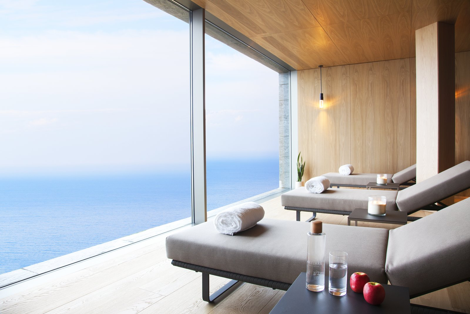 Living Room, Pendant Lighting, Chair, Recliner, and Light Hardwood Floor Kettal lounge chairs are featured in the wellness center.  Photo 8 of 13 in Spain's Basque Coast Gets a New Modern Hotel With a Michelin-Starred Restaurant