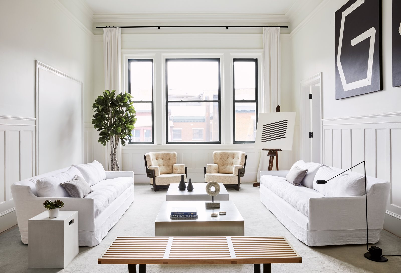 Living Room, Sofa, Chair, Bench, Coffee Tables, and Floor Lighting The pale pink armchairs have a quirky design and add an unexpected and subtle pop of color in an otherwise white interior.  Photo 9 of 10 in 5 Easy Tips From Modern Condos For Creating a Scandinavian-Inspired Interior