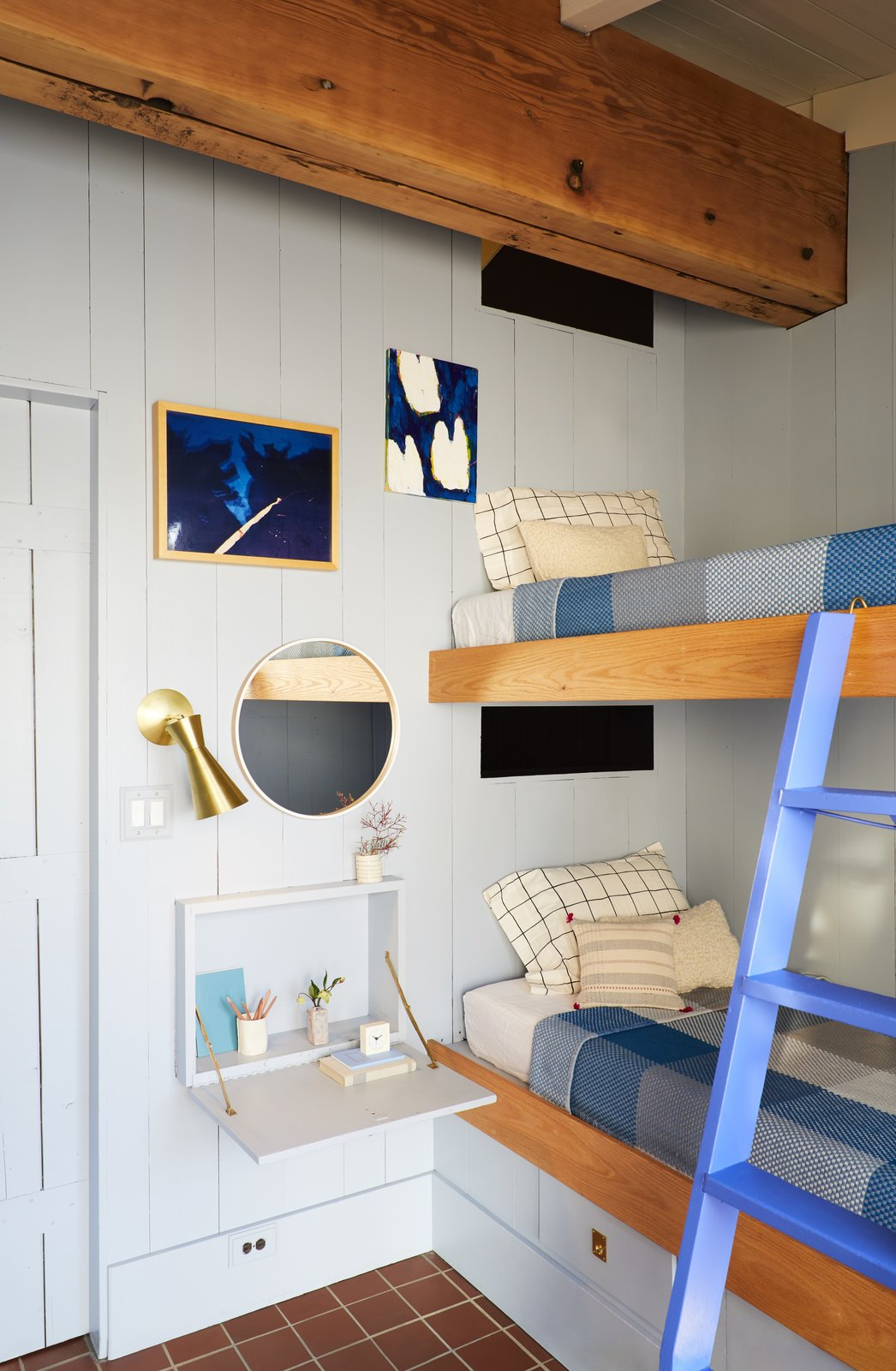 Bedroom, Bunks, Wall, Terra-cotta Tile, and Night Stands The bunk beds are original only repainted and treated to updated detailing.  Best Bedroom Night Stands Terra-cotta Tile Photos from A Hudson Valley Home's Renovation Is Guided by its Best Midcentury Feature