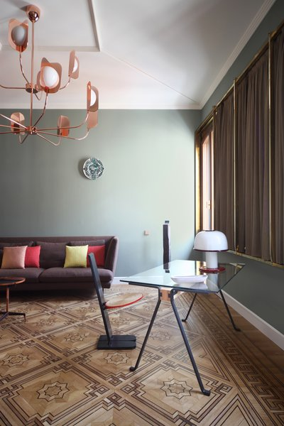 Lars sofa by Bonaldo, Leaf chandelier by MM Lampadari, Frate desk by Enzo Mari for Driade with table lamp by Sottsass for Vistosi,