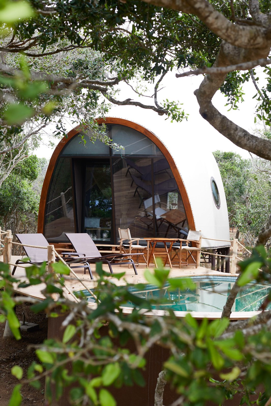 """The resort is made up of 28 air-conditioned and tented """"cocoon suites."""" The light-colored domed structures boast soaring vaulted ceilings and offer panoramic jungle views from their double-height glass facades."""