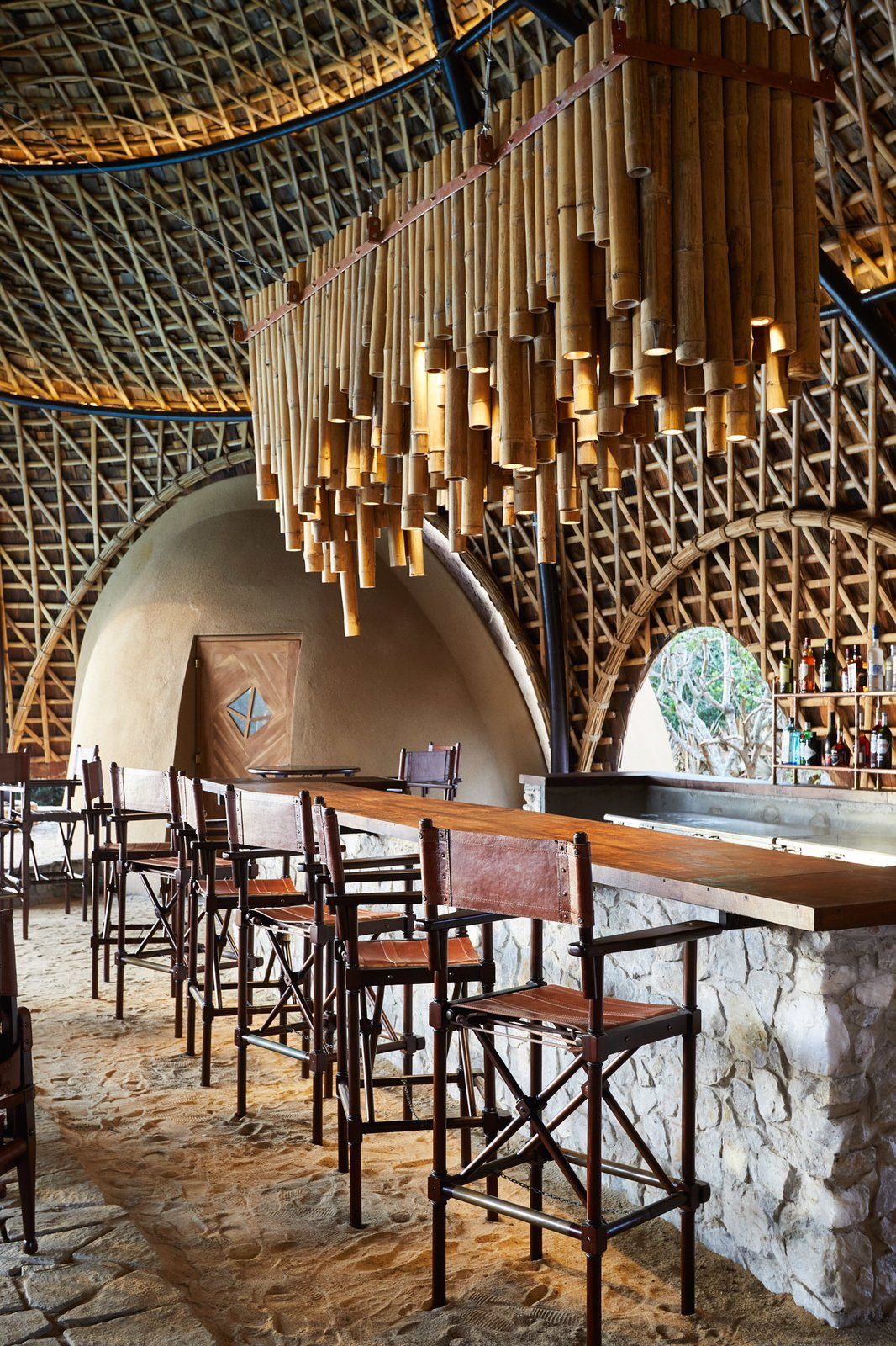 Dining Room, Bar, Stools, and Pendant Lighting Rates start from $924 per room per night on an all-inclusive basis based on two people. There's a two-night minimum stay.  Wild Coast Tented Lodge from Stay in a Cocoon-Like Tent at a Safari Resort in Sri Lanka