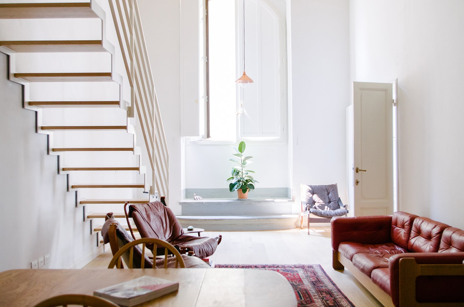 Staircase, Wood Tread, and Metal Railing Lofted mezzanine floors and bathrooms were added to the apartments. Room #1 is particulary bright and airy.  Best Photos from A 16th-Century Florentine Palazzo Is Transformed Into an Artist Residency