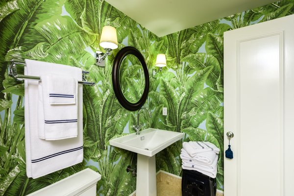 Fernando Wong's master bath brings the outdoors in with bold wallpaper.