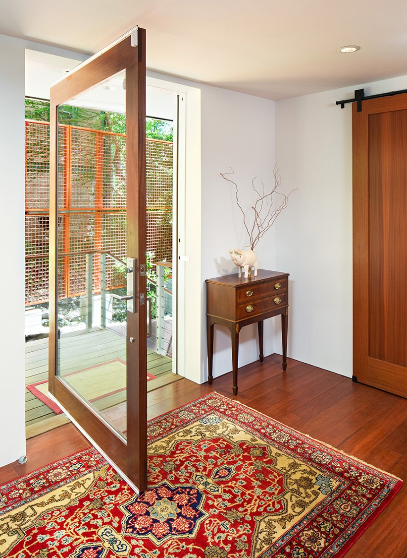The main entrance sets the tone for the bright and airy interiors.  Photo 3 of 16 in An Airy, Award-Winning Maryland Gem Hits the Market