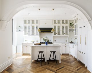 A kitchen island was added with bar stools from Sawkille and Bestlite Pendants from Gubi.