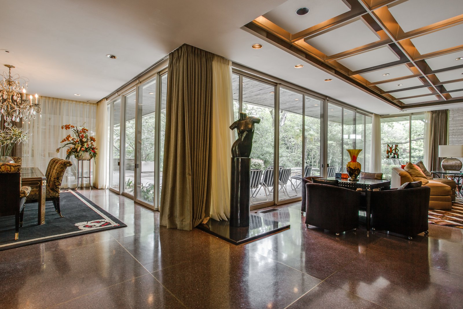 Living, End Tables, Ceiling, Sofa, Lamps, Table, Recessed, Chair, Table, and Terrazzo A series of sliding doors frame the exterior landscape and lead out to the patio.  Best Living Table Terrazzo Photos from A Frank Lloyd Wright-Inspired Waterfront Masterpiece in Dallas Is Up For Auction