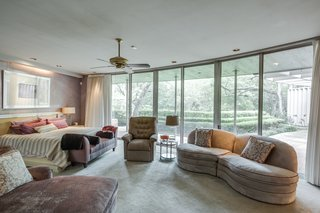 Designed for privacy, the master suite features giant sectional sliding doors and windows along with a unique geometric curved layout.