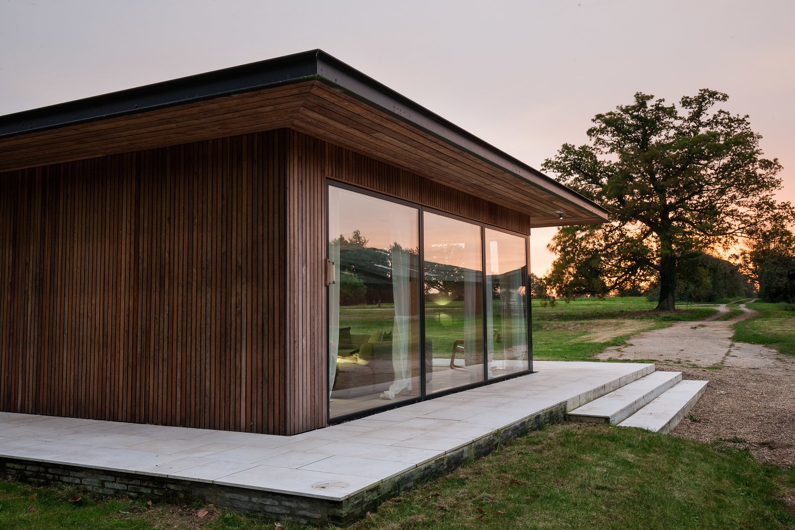 Exterior, Wood Siding Material, Mid-Century Building Type, Flat RoofLine, and Metal Roof Material A close-up of the home's elegant wood siding.  Photo 10 of 11 in A Scandinavian-Style Pavilion in England Is Listed For $2.1M