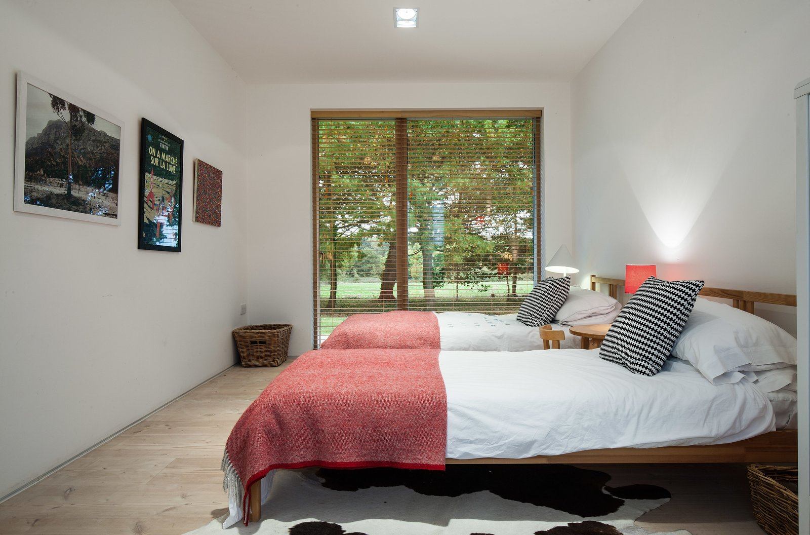 Bedroom, Night Stands, Light Hardwood Floor, Bed, Recessed Lighting, Rug Floor, and Chair Every bedroom offers views of the stunning countryside.  Photo 7 of 11 in A Scandinavian-Style Pavilion in England Is Listed For $2.1M