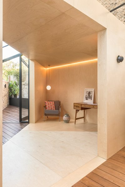 High-quality birch plywood lines the interior of this sharply angular and minimalist backyard office.