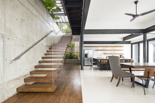The minimalist contemporary interiors blend hardwood floors with concrete and steel.