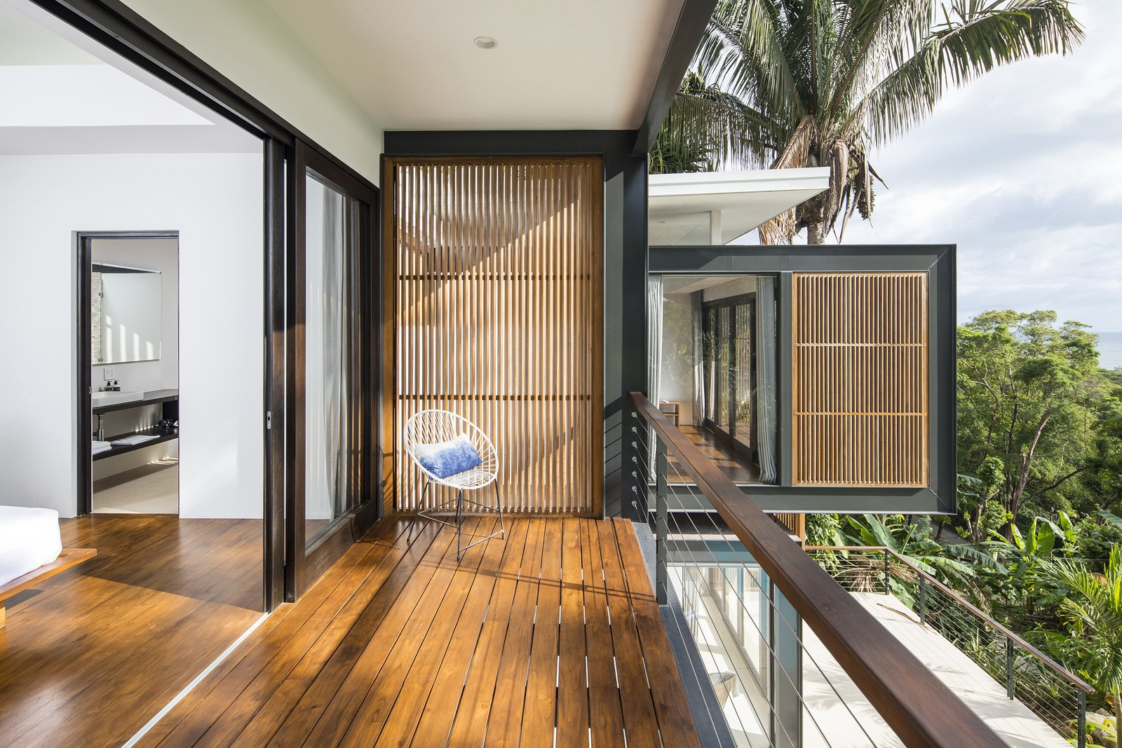 Outdoor, Wood, Trees, and Wire Staggered balconies add to the drama of the exterior without competing with the breathtaking view.  Outdoor Wire Photos from Slip Away to These Sleek New Villas in a Costa Rican Forest