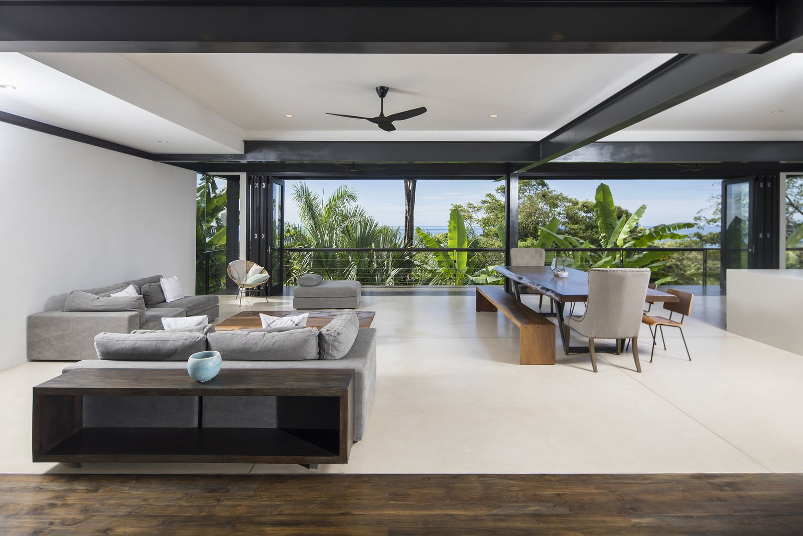 Living, Bench, Sofa, Dark Hardwood, Console Tables, Coffee Tables, Ottomans, Recessed, Chair, and Table The bright and airy open-plan living area in Casa Bri Bri.  Best Living Table Ottomans Photos from Slip Away to These Sleek New Villas in a Costa Rican Forest