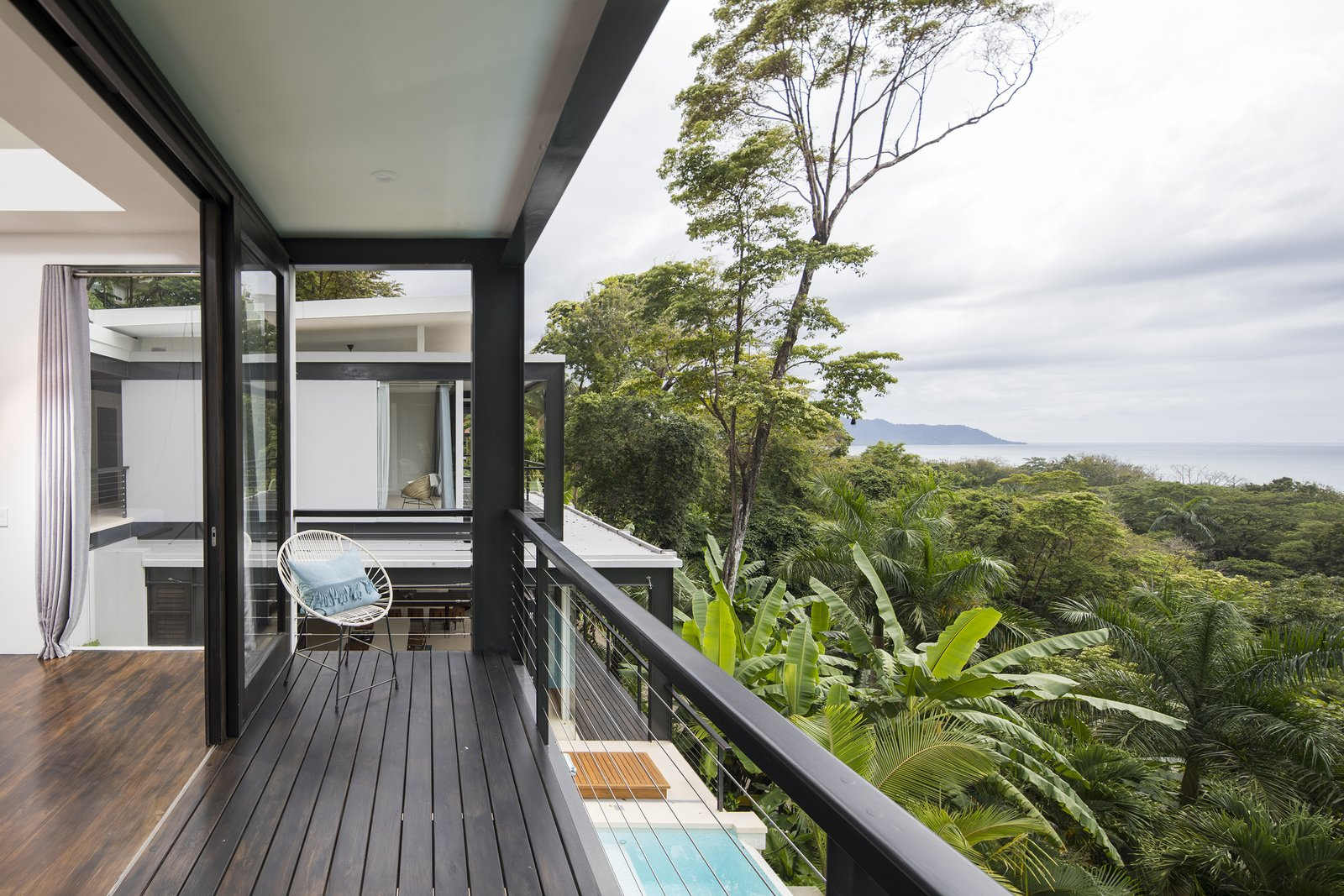 Outdoor, Wood, Metal, and Trees Unparalleled views of the Costa Rican coast can be enjoyed from the bedroom balcony.  Best Outdoor Metal Photos from Slip Away to These Sleek New Villas in a Costa Rican Forest