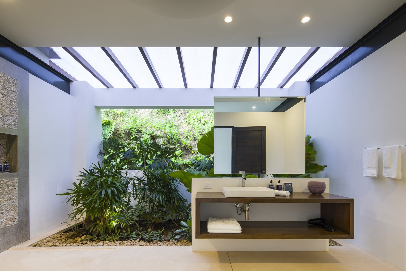 Bath, Wall Mount, Wood, Slate, Vessel, and Recessed The bathroom integrates a sense of the outdoors.  Dwell's Favorite Bath Recessed Photos from Slip Away to These Sleek New Villas in a Costa Rican Forest