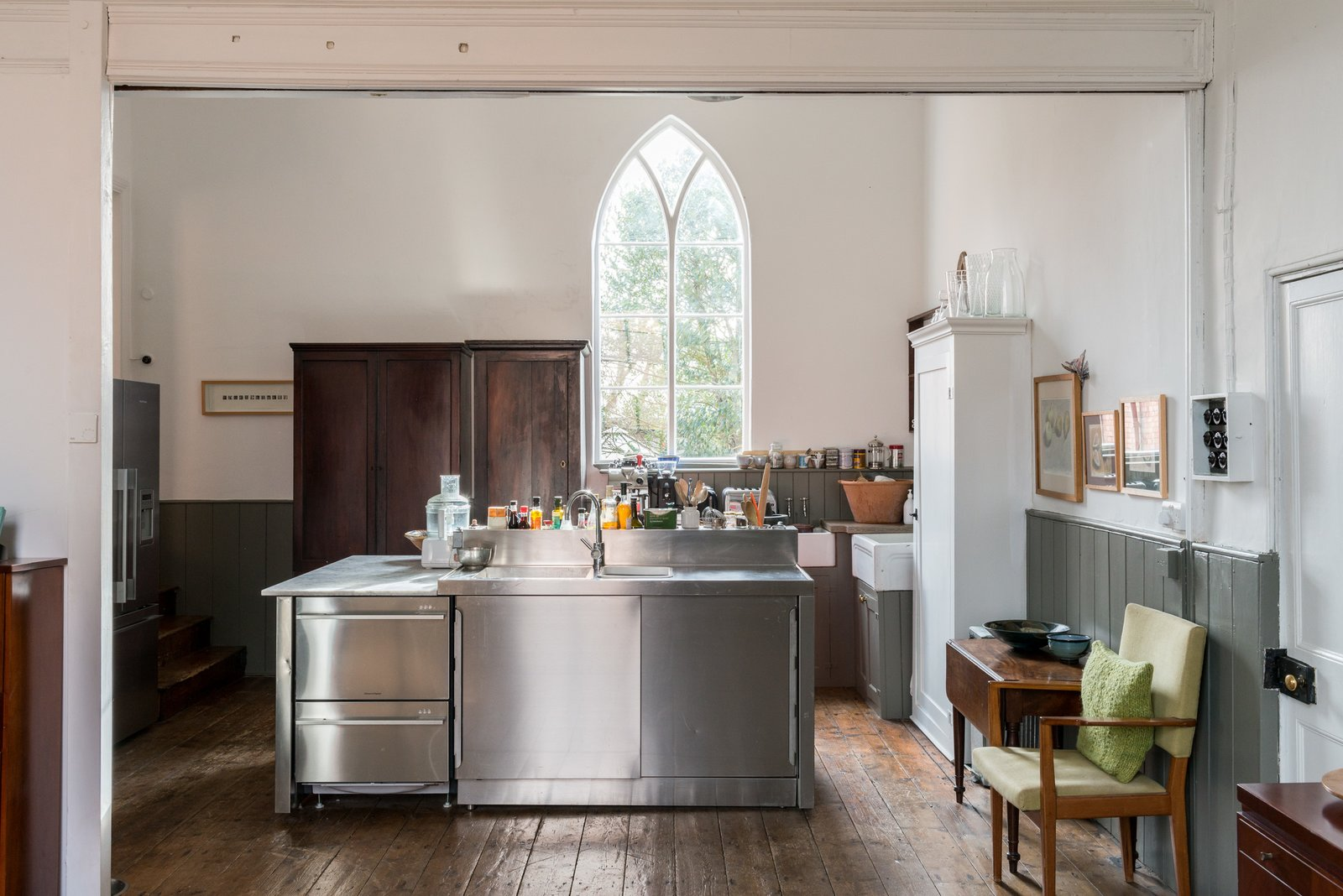 Kitchen, Wood Cabinet, Medium Hardwood Floor, and Metal Counter The kitchen layout takes consideration to a chef's needs.  Photos from A Converted 19th-Century Church in the English Countryside Asks $923K