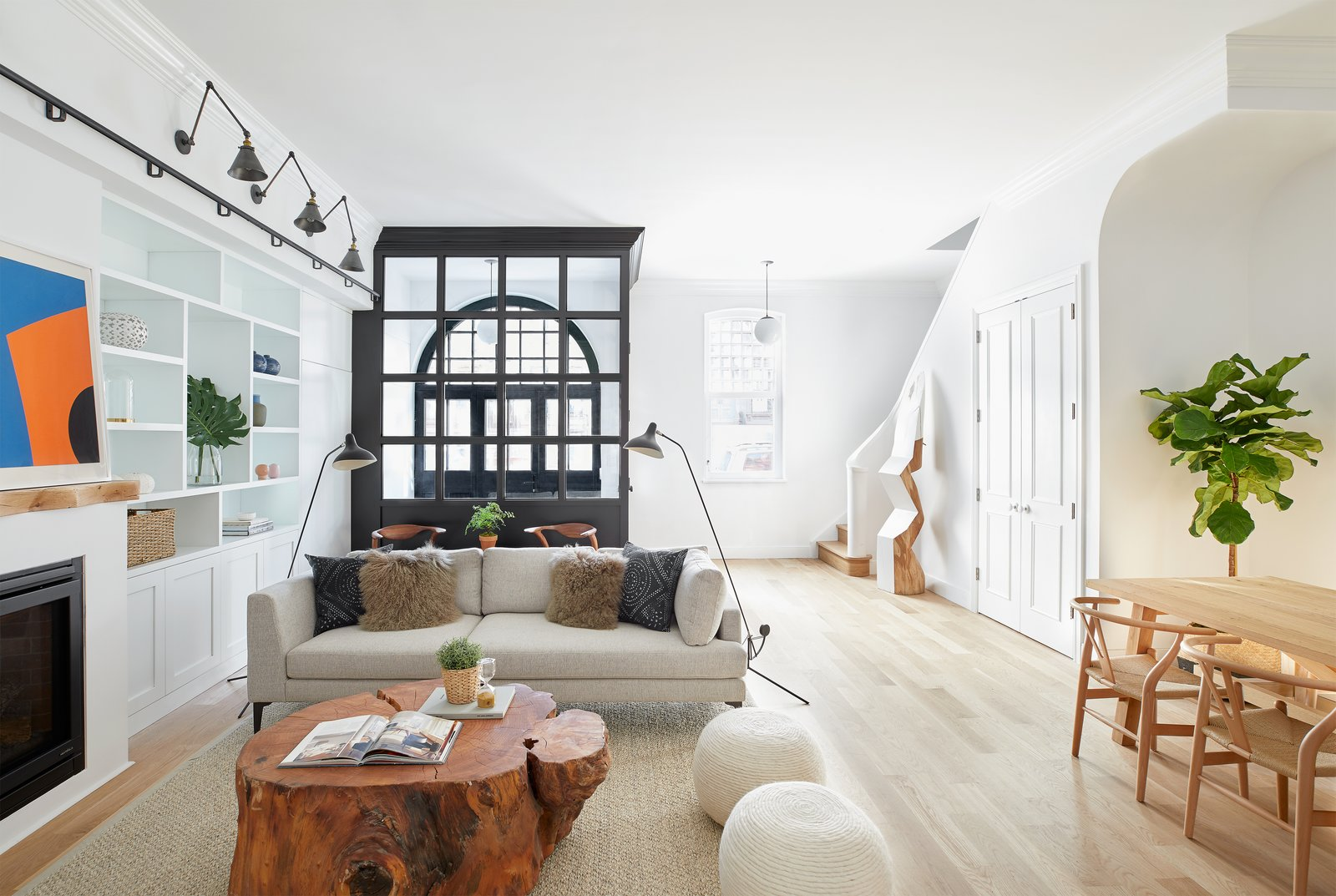 Living, Pendant, Bookcase, Ottomans, Chair, Accent, Light Hardwood, Sofa, Gas Burning, and Coffee Tables The luminous living area of 409 Vanderbilt Avenue.  Living Ottomans Gas Burning Accent Photos from Two Renovated Carriage Houses in Brooklyn Hit the Market
